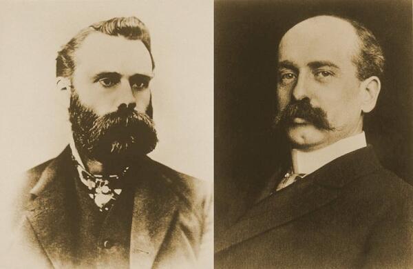 Чарльз Доу (1851–1902) (слева) и Эдвард Джонс (1856–1920)