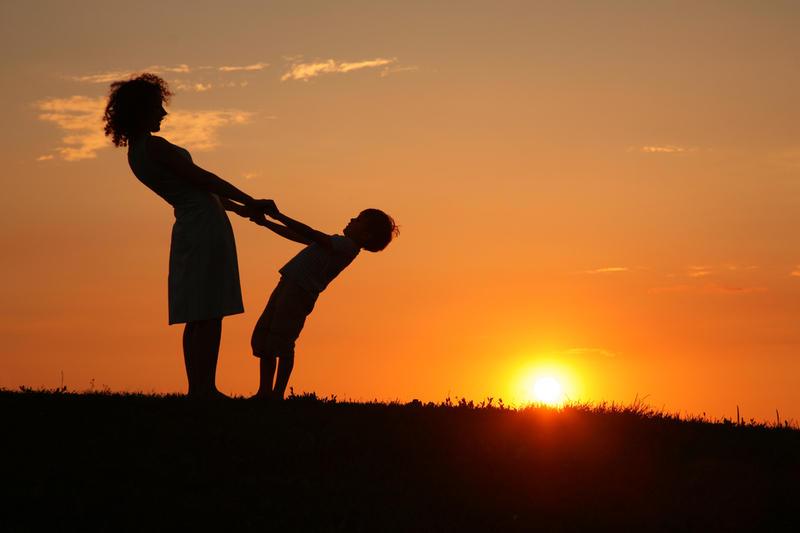 Mother And Son On Sunset Holding By Hands Фотография, картинки, изображения и сток-фотография без роялти. Image 5106098.