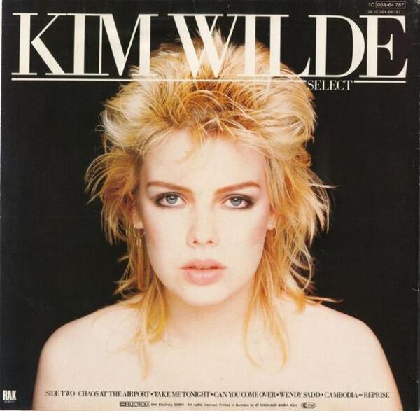 Имидж Ким Уайлд - типичный образ девчонки начала 1980-х - с обильным агрессивным макияжем и модной причёской