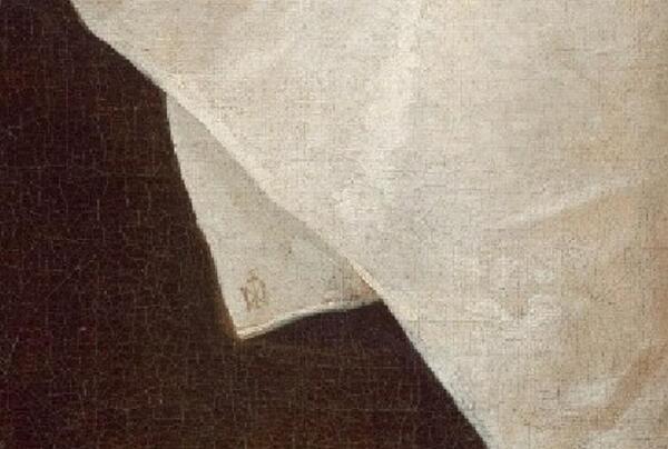 Виллем Клас Хеда, Банкет с мясным пирогом, фрагмент «Марка изготовителя скатерти»