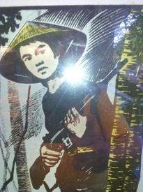 Плакат с вьетконговцем 60-х годов прошлого века. Красный партизан