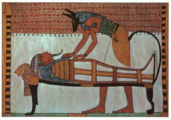 Анубис с мумией. Роспись на стене гробницы Сеннеджема.