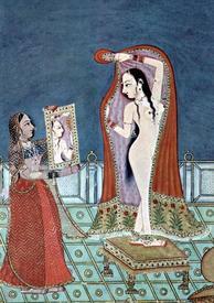 Индийская красавица одевается.