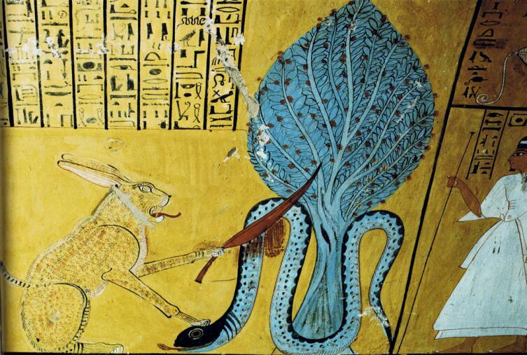 Ра в образе кота убивает змея Апопа.