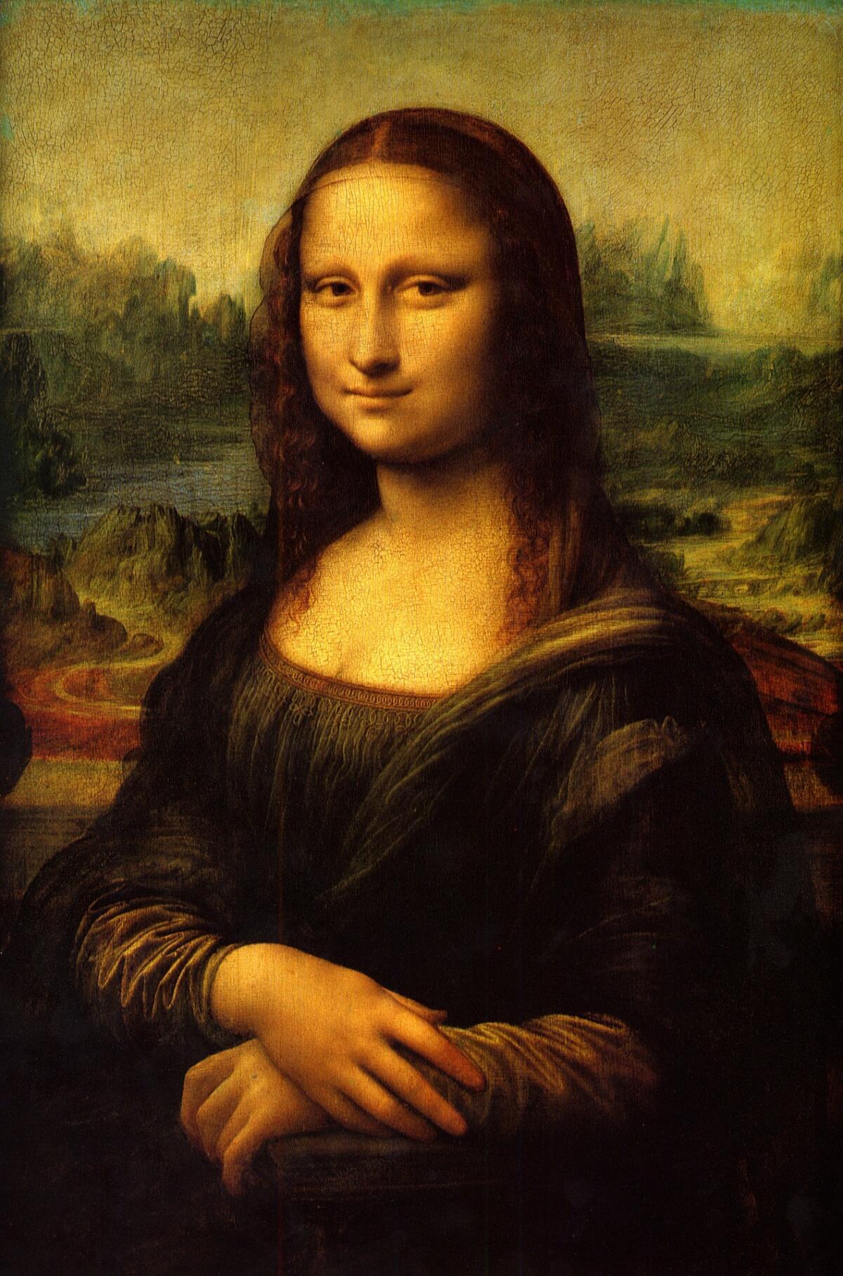 Правая половина лица Мона Лизы улыбается, а левая выражает нейтральные или негативные эмоции