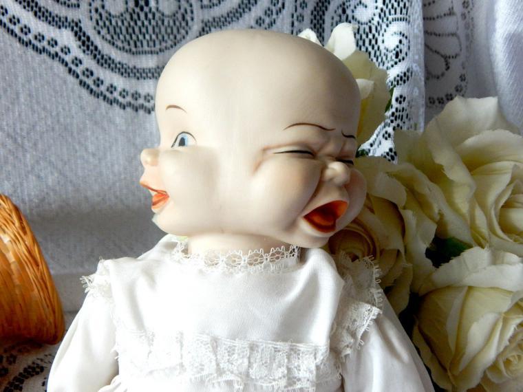 Трёхликая кукла-младенец