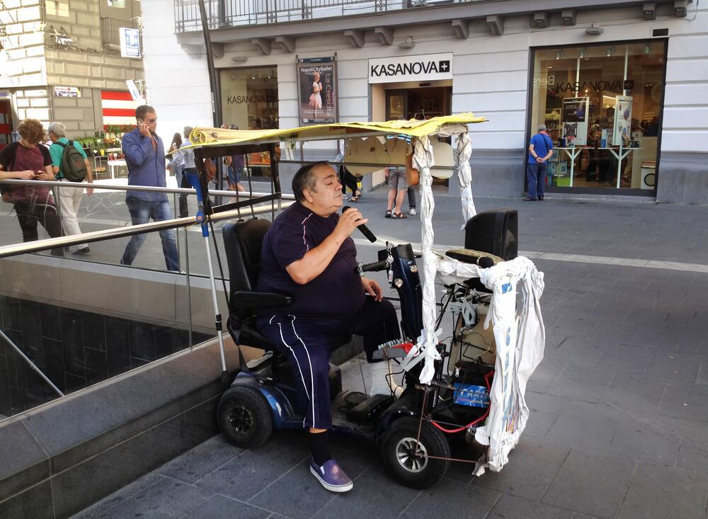 Уличный исполнитель неаполитанских песен