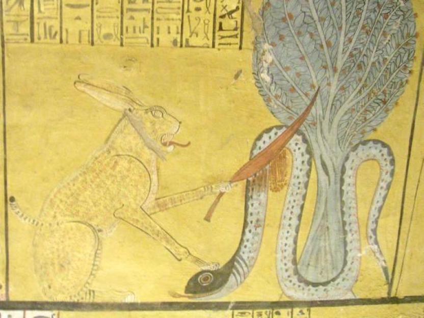 Бог Ра в образе рыжего кота побеждает змея Апола