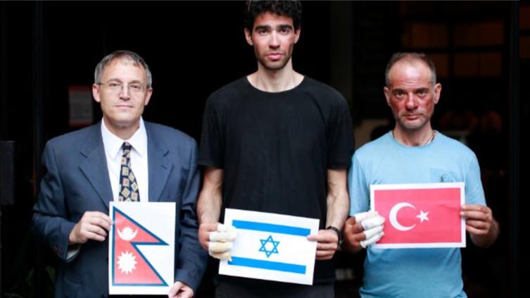 Надав Бен Йегуда и спасенный им турецкий альпинист