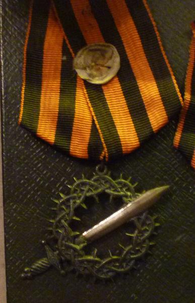 Награда Добровольческой армии «Знак отличия Первого Кубанского похода» («За Ледяной поход») на Георгиевской ленте
