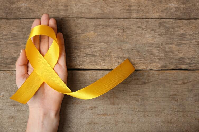 Желтая лента - символ проблемы самоубийств и их предупреждения