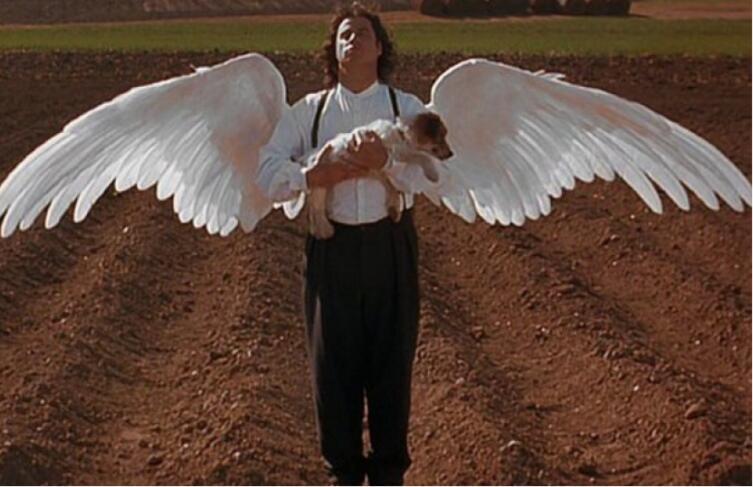 Кадр из к/ф «Майкл», 1996 г.